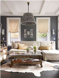 Iris  adds style to your space even if its a Rental, on a Budget. Add paint color, unique design objects, Hanging lamp, slip covering ur existing furniture & adding window treatments for a Stylish Modern Look.