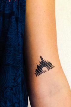 You're never too old for Disney. Two tattoos of Cinderella's castle with the words Forever Young Easy Application lasting 2-5 days. Measures 1.5 by 2 inches.