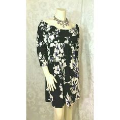 Tiana B Dress Black dress  with with & purple colored flowers by Tiana B. Can me worn over shoulders or off the shoulders to accent neckline.   Details: Size Medium  Elastic Scoop neckline Bell Sleeves Elastic waist 95% Polyester 5% Spandex Preowned. Excellent condition Tiana B Dresses