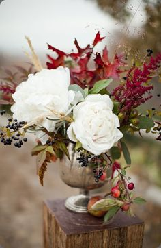 gorgeous compote arrangement lush white flowers, burgundy astilbe and fall leaves and some seasonal berries/fruits by Honey of a Thousand Flowers
