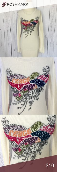 """Lucky Brand L/S Thermal Embroidered multi-color XS Lucky Brand Long Sleeve thermal.  Ivory background with beautiful embroidery  The image is the peace dove and words """"Love, Peace, Hope, Harmony, happiness,  friends, luck, and good times"""" Contrast stitching in orange  Long sleeve Brand:  Lucky Brand (label removed) Size:  XS (label removed) 100% cotton  *Please check out my shop for fabulous fashion. I'm happy to bundle. Lucky Brand Tops Tees - Long Sleeve"""