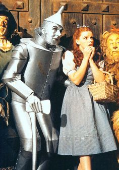 The Wizard of Oz, right before the Scarecrow proves he has more brains than anybody and grabs the ax, hacking the rope and dropping the huge wooden light fixture on the soldiers.