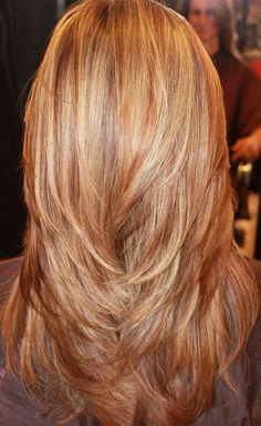 Rain by Melodi - Charlotte, NC, United States. long layers, red, blonde, and golden highlights