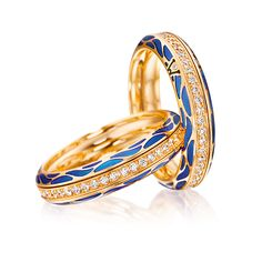 Cellini Jewelers 'Genuine Delight, Ocean' Ring by Wellendorff  'Genuine Delight, Ocean' spinning band ring in blue cold enamel, with a central row of diamonds; Handcrafted in 18-karat yellow gold;interior is engraved with your personal winged guardian angel.