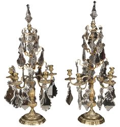 """Pair of Louis XV five light bronze and crystal candelabra with elaborate shaped bases, fluted shafts, and crystal finials. CIRCA: Late 19th Century DIMENSIONS: 30"""" h x 14"""" w"""