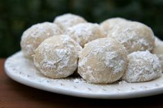 Italian Wedding Cookies: 11/2c unsalted butter 3/4c powered sugar 1/2tsp salt 1 1/2c finely ground almonds 4 1/2tsp vanilla extract 3c flour Lots of extra powdered sugar for rolling Preheat oven 325 deg Add butter/powdered sugar to bowl. Cream together. Add salt. Beat everything until light & fluffy. Add almonds/vanilla extract. Mix. Gradually blend in flour. Use 1tsp of dough for each cookie. Shape with hand into ball. Place on ungreased cookie sheet. Bake 15-20 mins. C...