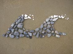 Stone art-put out a bunch of rocks and other materials as a provocation. I am going to create a book of photos of stone art to get them started of things my kids have made on the beach.