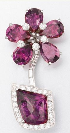 PLATINUM, TOURMALINE AND DIAMOND BROOCH, NOAZ BREEN 6 tourmalines and 32 diamonds approx 16.75 and 1.20 cts, 1 7/8 ins.