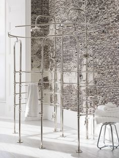 La Cage double shower enclosure set against brick wall by Catchpole and Rye for a Scandinavian hygge home.
