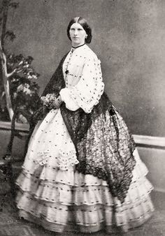 Lovely dress with lace shawl. 1850's dress I believe by the tiers.