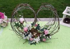 Twig and Chicken Wire Heart Flower Arrangement, could be a centerpiece for Mother's Day dinner--not just one sided