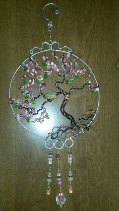Wire wrapped beaded Tree of life sun catcher with nest. Cherry blossom.