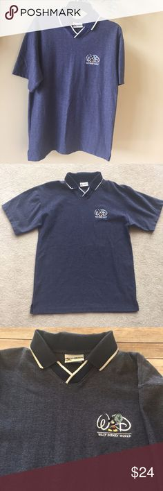"""Disney World Mickey Men's Blue Golf Polo Shirt L This is a Very Nice Walt Disney World Mickey Mouse Men's Dark Blue Polo Golf Shirt   It is a great gift for the Disney Golfer in your life or just for yourself. It is in Great Condition   Material 100% Cotton Style Golf Polo Color Dark Blue almost a Gray/Blue Size Large The chest is 44"""" (22""""across at the armpits) Disney Shirts Polos"""