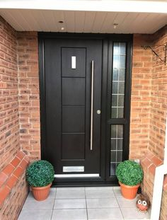 A black Dakota fitted with bar handle and rectangle knocker to add a contemporary touch. Front Door Canopy, Front Door Porch, Black Front Doors, Porch Doors, Front Door Entrance, Black Composite Front Door, Composite Door, Contemporary Front Doors, Modern Front Door