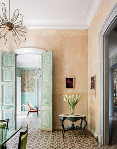 A Havana Home -- In the dining room, photographs by Bastian hang over a table from the house's previous owner, whom Ruiz befriended. Photo: Stefan Ruiz