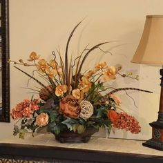 "Tan and Brown Silk Orchid Centerpiece with Feathers AR321 - Elegantly styled in beautiful resin bowl, with a unique appeal. Created with orchids, pheasant feathers, hydrangeas, & greenery 28"" L x 26"" H #silkorchids"