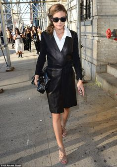Olivia Palermo leaving the DVF show in a sexy black leather wrap-style trench worn over a white shirt l September 7th, 2014