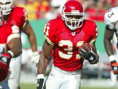 Priest Holmes running for a big gain against the Broncos