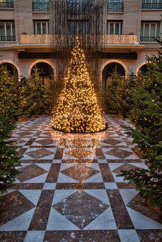 Electric Light Bulb Christmas Tree and Gold Reindeer in Paris - My Modern Met
