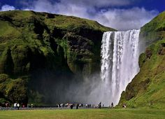 The Skogafoss Waterfall – A beautiful waterfall located in south of Iceland. The waterfall is rivals the Famous Gullfoss Waterfall of Iceland. The Skógafoss Wat Iceland Country, Places To Travel, Places To Visit, Iceland Waterfalls, Les Cascades, All Nature, Beautiful Waterfalls, Famous Waterfalls, Iceland Travel