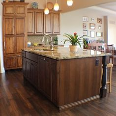 A kitchen island with applied decorative doors on back panel and