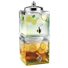 Two-tier glass beverage dispenser.   Product: Dual drink dispenserConstruction Material: Chrome and glassColor: Clear and silverFeatures:  Eliminates sticky handles and spills2.8 Gallon capacity overall Note: For use with cold beverages only. Assembly required.Cleaning and Care: Handwash