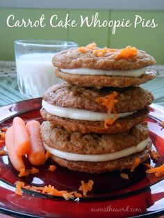 These Carrot Cake Whoopie Pies are absolutely amazing. Two carrot cake cookies with a cream cheese frosting squished in the middle = HEAVEN. Really these are amazing! #dessert #cookie #sandwichcookies #whoopiepies #carrot #carrotcake #carrotcakecookies #creamcheese #frosting #creamcheesefrosting #christmas #easter #recipe #numstheword