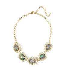 A row of faceted teardrop stones filled with borealis wisps will add soft glamour to any outfit.Item Details: Length: 16
