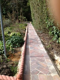 Brick path edged with rope edgings.