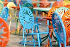 """Kicking off the Memorial Union Reinvestment project, 300 limited-edition """"Mendota Blue"""" chairs were delivered to the UW's Memorial Union Terrace Sunday to join the Terrace's iconic green, orange and yellow sunburst chairs."""