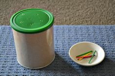 Easy threading activity with recycled containers howwemontessori.com