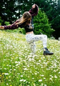 *Antonia (youngest daughter of Sally Owens) running through a field of flowers, yearning to find her artistic and radical individuality.  She has the power to call the wind and the rain elements.