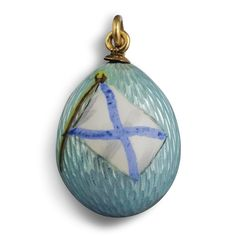 A Fabergé gold and enamel egg pendant, workmaster Feodor Afanassiev, St Petersburg enamelled with the Russian naval flag on a translucent pale sea green ground