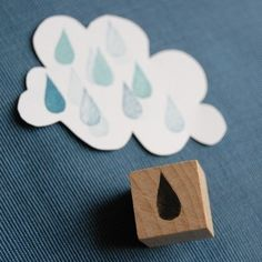 Rain Drop Stamp.  Stamps are easy to make on your own.  Cut out the shape out of craft foam and stick it on a wood piece (like in the photo), and ta da!  Or you can use a ballpoint pen and make lines in the craft foam.  It works both ways!