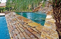 Swimming pool with two rock waterfalls