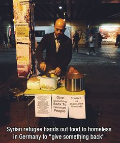 """Syrian refugee hands out food to homeless in Germany to """"give something back""""."""