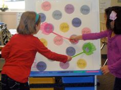 """Slap the Word"" - say a word from the board. The two students have flyswatters to slap the word. The student who slaps the correct word first wins."