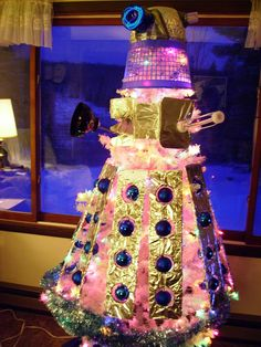 Hard to believe a shiny pink Dalek would menace anyone, but clearly it would. This brilliantly mad sculpture was created by Minnesota animator Lindsey Testolin. There is actually a tree under there. [via Flickr]