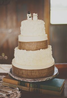 white and burlap wedding cake with owl toppers captured by Kendra Michelle Photography http://www.weddingchicks.com/vendor-guide/kendra-michelle-photography/