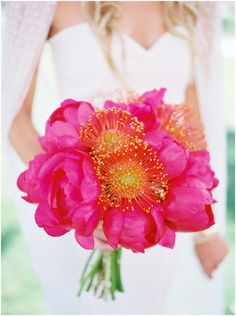 Awesome hot pink peony and pincushion protea bouquet!