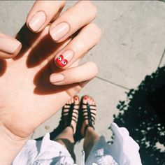 """The 13 Raddest Manicures In L.A. — & The Woman Behind Them All #refinery29 http://www.refinery29.com/2015/08/92917/olive-june-nail-salon-sarah-gibson-tuttle-interview#slide-3 """"Two things about this mani: First, I love a good nude nail. Second, the Comme des Garçons heart is one of the best ways to get nail art noticed.""""..."""