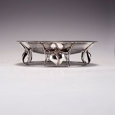 Josef Hoffmann, Vienna. Centrepiece, c1911. Base with leaf tendrils, beaded rims. H. 4.7 cm; D. 16.4 cm. Made by Alfred Maier, silversmith at Wiener Werkstätte. Silver. Marked: Initials of Alfred Maier, A, Diana's head, WW, rose mark and initials of Josef Hoffmann.