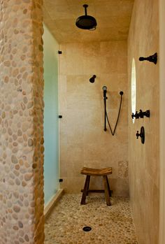 Pebble texture and stone Master Shower tropical bathroom