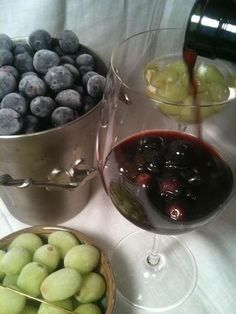 Freeze grapes to chill white wine to avoid watering it down.