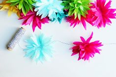 a sweet tutorial on how to create tissue paper flowers.  My kids will love these!