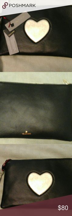 Clutch Ora Delphine new clutch.  Black with gold heart.  Leather, inside zippered pocket and open pocket.  Zipper close.  Current style. Ora Delphine  Bags Clutches & Wristlets