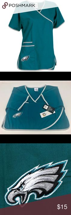 Philadelphia Eagles Scrub Dudz Top Brand New Officially Licensed with tags. Wear your team pride at work in this fun scub top. 65% poly/35% cotton with double front pocket for easy reach, side slits at the hem and embroidered graphics with contrast color piping.  746507149933 Scrub Dudz Tops