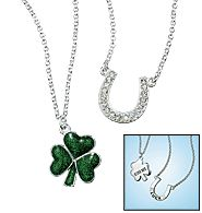"""Silvertone pendants on 17"""" L chain with 3"""" extender. Horseshoe with rhinestone accents (on reverse is the word """"Luck"""") and enamel-look clover (on reverse is the phrase """"Kiss Me"""")."""
