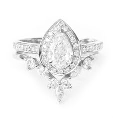 Beautiful pear diamond halo engagement ring with matching diamond nesting ring Hermes - Wedding / Bridal rings set. List is for 2 rings. Product detail: ♥ Center stone: Amazing natural diamond pear shape, 0.7ct, Color H+ (or higher), Clarity Si2+ (or higher), comes with GIA