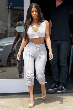 Kim Kardashian West's Best New Looks: In a white plunging crop top, gray drawstring sweatpants and Yeezy heels out in Sherman Oaks, California.